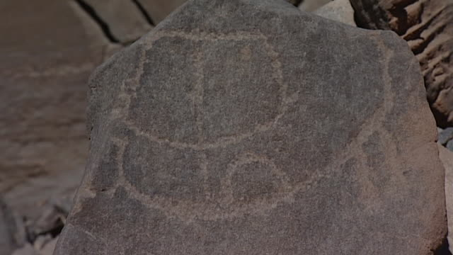 eastern desert rock art. mcu boat with sail petroglyph. - extreme terrain stock videos & royalty-free footage