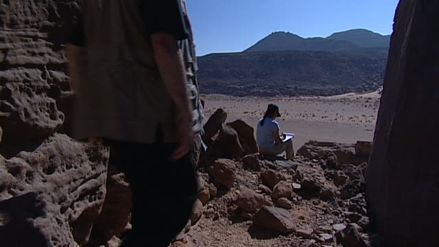 eastern desert. view of an archaeologist sketching a wadi in the eastern desert. - archaeologist stock videos & royalty-free footage