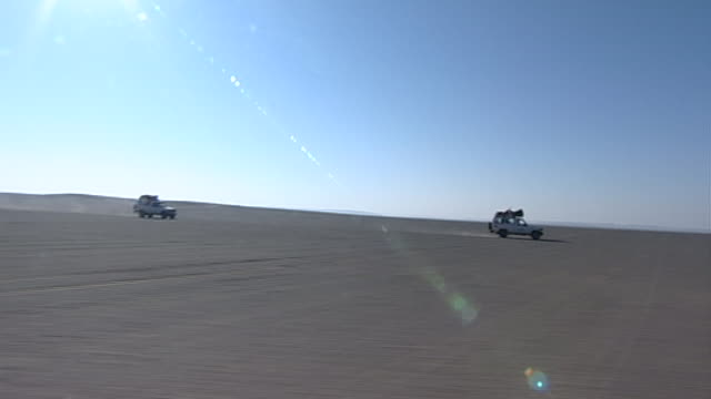 eastern desert wide of a jeep convoy in the desert - extreme terrain stock videos & royalty-free footage