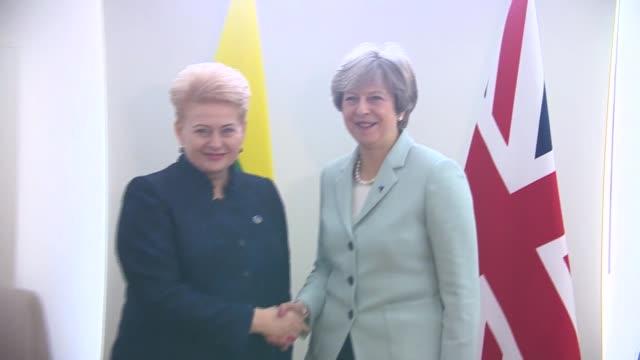 Theresa May meets Dalia Grybauskaite BELGIUM Brussels PHOTOGRAPHY** Theresa May MP shaking hands with Dalia Grybauskaite then taking seats and...