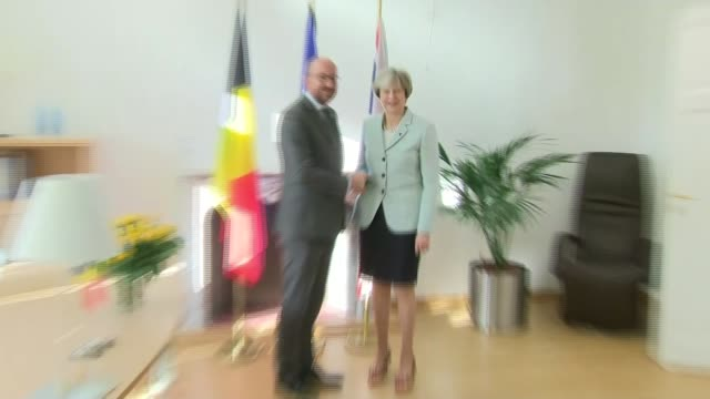 Theresa May meets with Charles Michel BELGIUM Brussels PHOTOGRAPHY** Theresa May MP and Charles Michel shaking hands and sit down at table