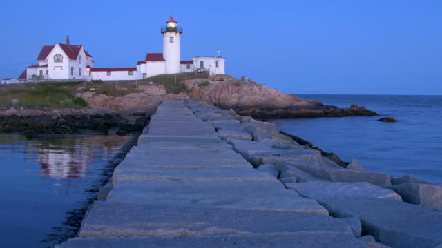 eastern point lighthouse on the east side of the gloucester harbor - gloucester massachusetts stock videos & royalty-free footage