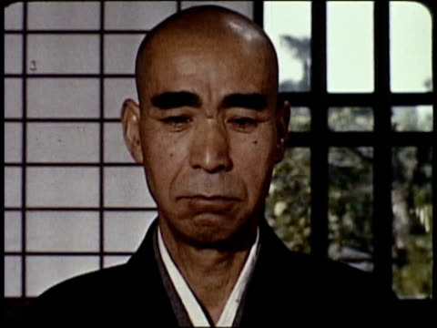 stockvideo's en b-roll-footage met 1963 montage eastern shintoist monks meditating and performing traditional ritual / japan  - 1963