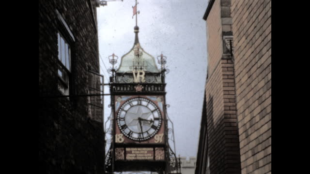 "eastgate clock; time at 3:28 with the words ""vr"" ""1897"" and ""this clock was presented to the city by donald evans ... 1897"" - 19th century style stock videos & royalty-free footage"