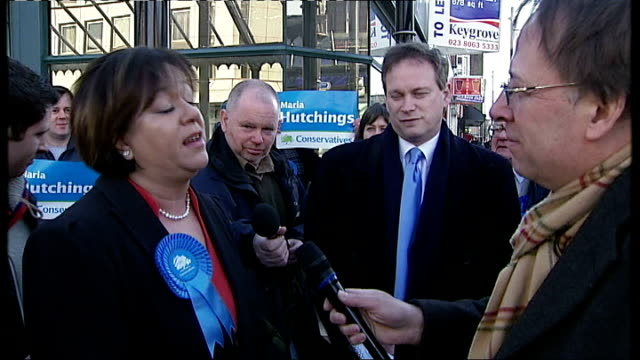 eastleigh constituency byelection candidates england hampshire eastleigh ext various shots maria hutchings walking along with supporters wearing blue... - floella benjamin stock videos & royalty-free footage