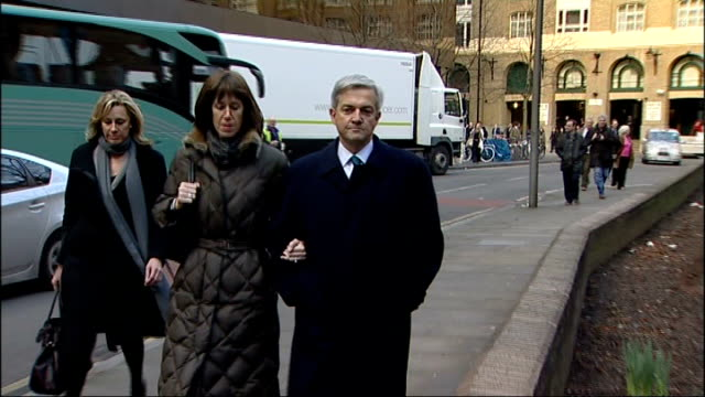 eastleigh constituency byelection to follow chris huhne resignation southwark crown court huhne and trimingham along as arriving at court - politische gruppe stock-videos und b-roll-filmmaterial