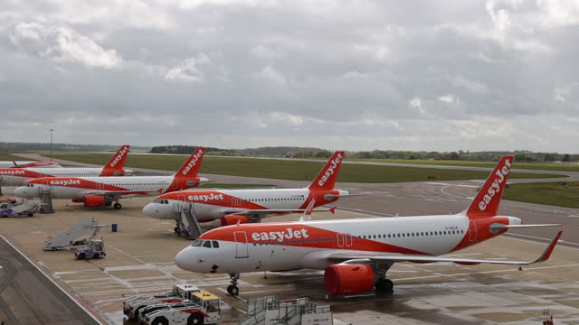 easyjest airplanes in row at london luton airport in london, england, uk, on monday, may 10, 2021. - luton airport stock videos & royalty-free footage