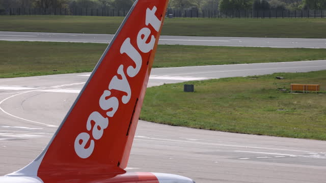easyjet and ryanair airplanes at london airports as covid-19 travel restrictions are lifted in london, england, uk, on monday, may 10, 2021. - luton airport stock videos & royalty-free footage
