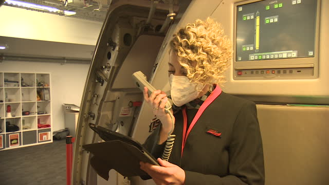 easyjet cabin crew refreshing skills and emergency exit routines at training centre at gatwick airport during coronavirus pandemic - information sign stock videos & royalty-free footage