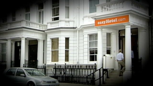 easyjet founder announces plans to launch rival airline fastjet august 2005 / t01080534 south kensington entrance to new budget hotel with sign above... - founder stock videos and b-roll footage