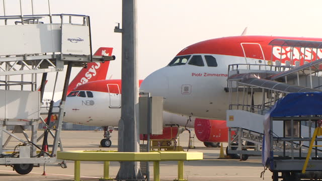 easyjet planes parked up at gatwick airport, as travel restrictions continue during coronavirus pandemic - stationary stock videos & royalty-free footage