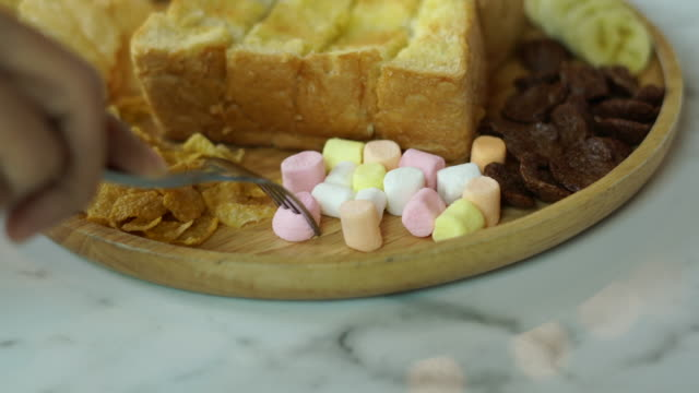 eat marshmallow with fork - jellybean stock videos & royalty-free footage