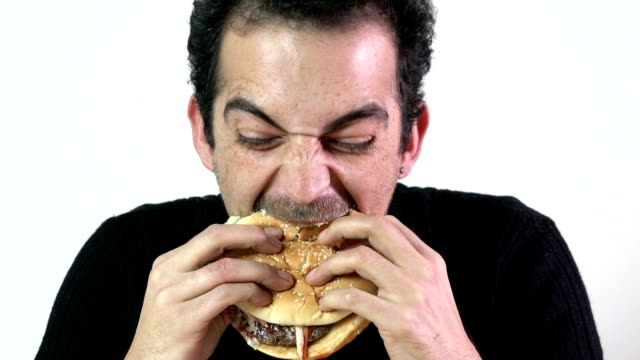 eating a burger slow motion - greed stock videos and b-roll footage