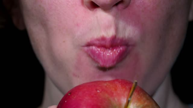 eating an apple - human mouth stock videos & royalty-free footage