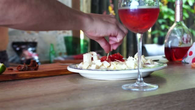 eating appetizer food before the barbecue on a beach house in brazil - south america stock videos & royalty-free footage
