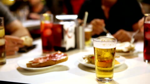 eating at a typical spanish tapas bar - spanish culture stock videos & royalty-free footage