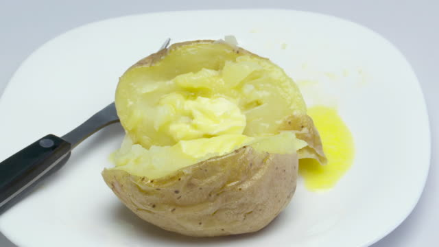 eating baked potato with fork - baked potato stock videos & royalty-free footage