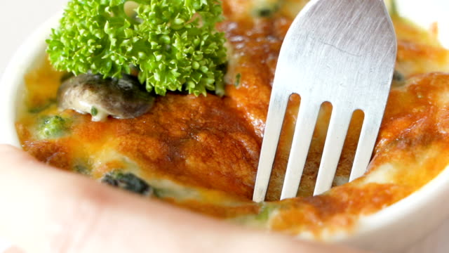 eating baked spinach with cheese. - lasagna stock videos & royalty-free footage