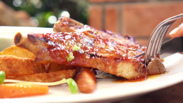 eating bbq  steak - bbq sauce stock videos and b-roll footage