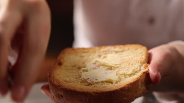 eating bread with butter and honey - loaf of bread stock videos & royalty-free footage