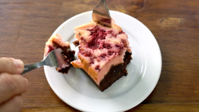 eating brownie raspberries cake. - plate stock videos & royalty-free footage