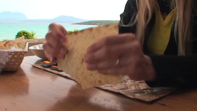 eating carasau bread,sardinian speciality - sardinia stock videos & royalty-free footage