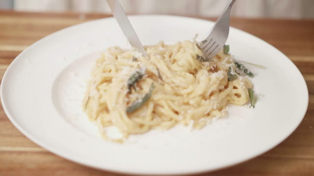 eating creamy butternut squash linguine - linguini stock videos and b-roll footage
