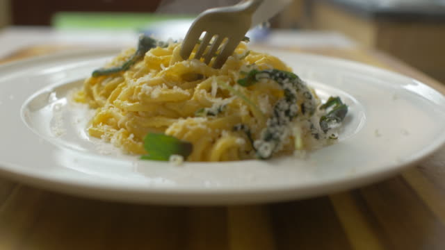 eating creamy butternut squash linguine - spaghetti stock videos & royalty-free footage