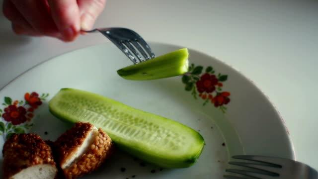eating cucumber and sesame bagel - bagel stock videos & royalty-free footage