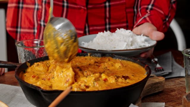 eating delicous homemade chicken curry dish with rice - bowl stock videos & royalty-free footage