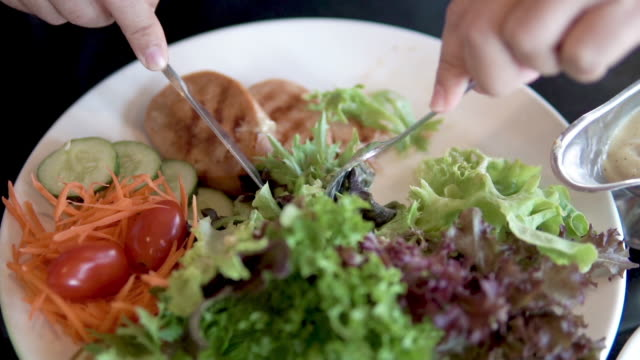 eating fresh salad. - salad dressing stock videos & royalty-free footage