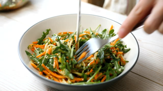 eating freshness carrot,cucumber salad - raw food diet stock videos & royalty-free footage