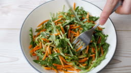 eating freshness carrot,cucumber salad