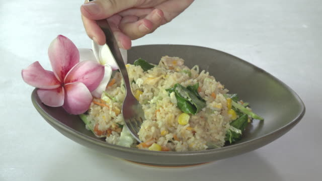 eating fried rice with vegetables, typical thai food - fried rice stock videos and b-roll footage