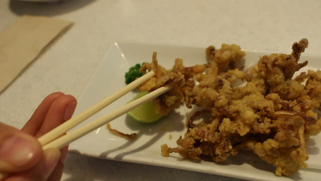 eating fried squid japanese food - toro fish stock videos and b-roll footage