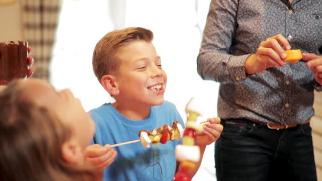 eating fruit kebab - dining table stock videos & royalty-free footage