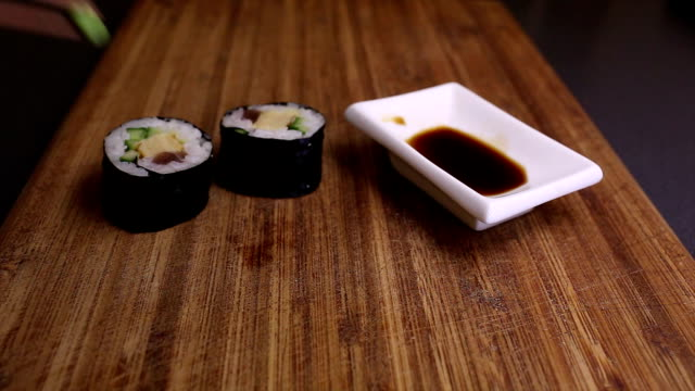 eating futomaki sushi - wasabi stock videos and b-roll footage