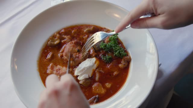 eating goulash and stew in a restaurant - spoon stock videos & royalty-free footage