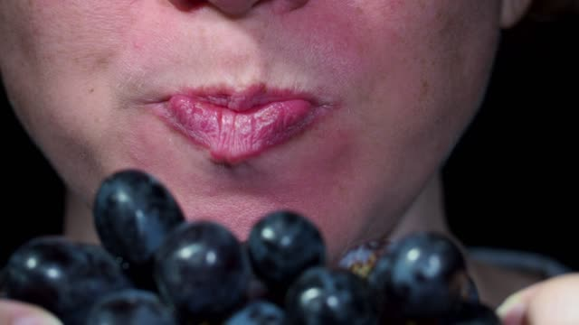 eating grapes - human mouth stock videos & royalty-free footage