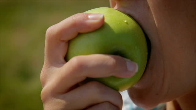 eating green apple.close up - chewing stock videos & royalty-free footage