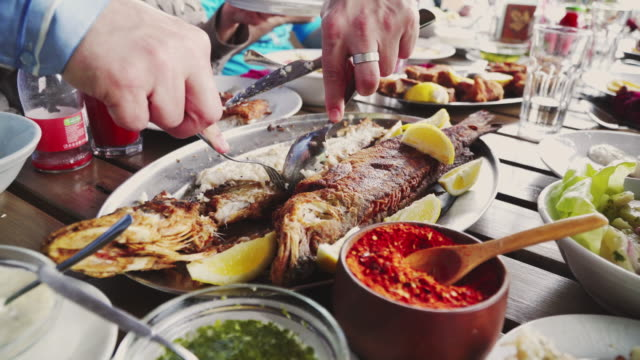 eating grilled fish in restaurant - filleted stock videos & royalty-free footage