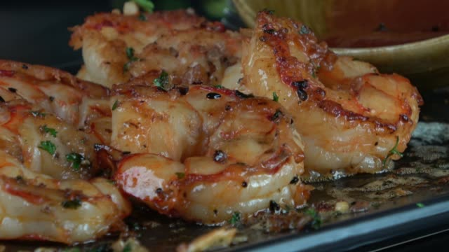 eating grilled garlic prawns with spicy dipping sauce - ketogenic diet stock videos & royalty-free footage