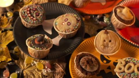hd dolly: eating halloween cupcake - indulgence stock videos & royalty-free footage