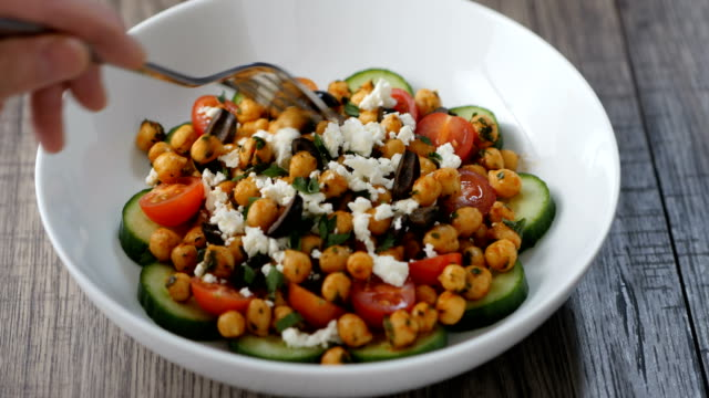 eating healthy chickpea bowl - greek food stock videos & royalty-free footage