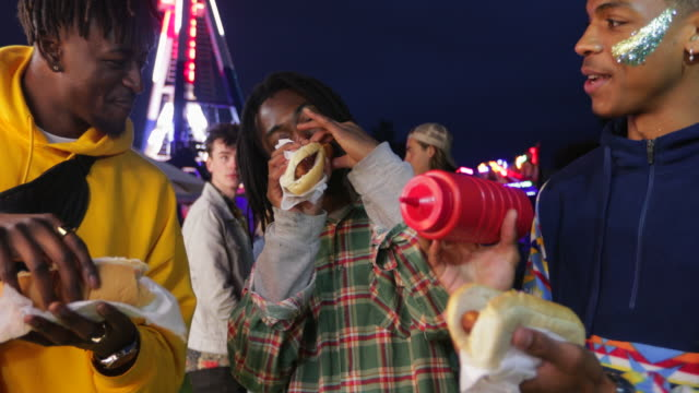 eating hotdogs at a festival - hot dog stock videos & royalty-free footage