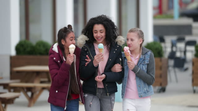eating ice cream is not just for sunny days - only teenage girls stock videos & royalty-free footage