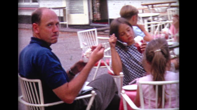 1967 eating ice-cream in outdoor cafe