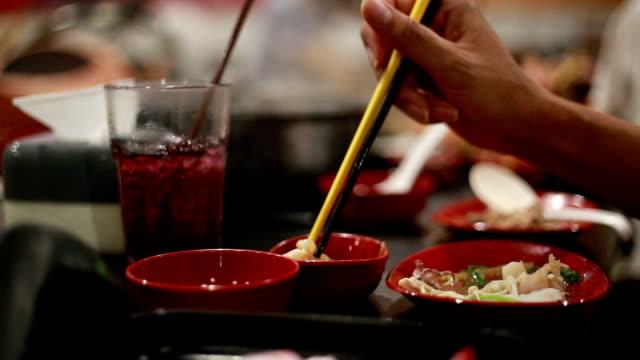 eating in restaurants - sukiyaki stock videos and b-roll footage