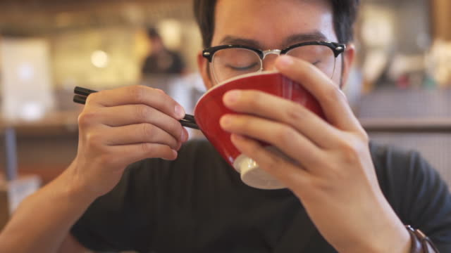 eating japanese food in restaurant - eating stock videos & royalty-free footage