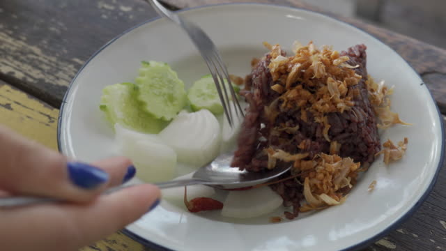 eating khao ngeaw, traditional steamed rice in chiang mai ,thailand - mack2happy stock videos and b-roll footage